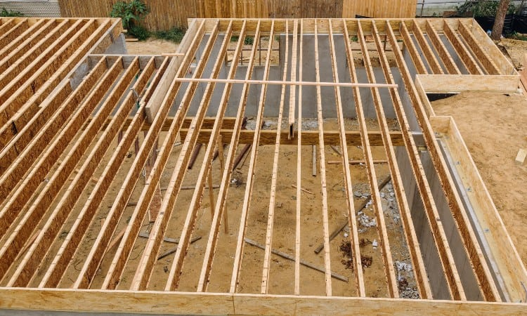 Engineered floor joists vs 2×10