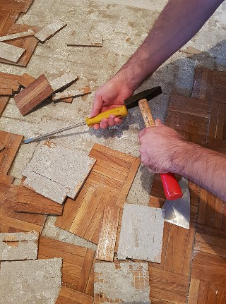 Removing glued hardwood flooring